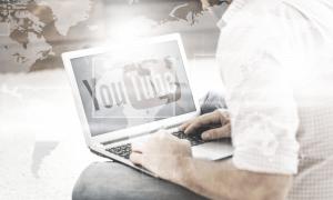 man on laptop watching YouTube